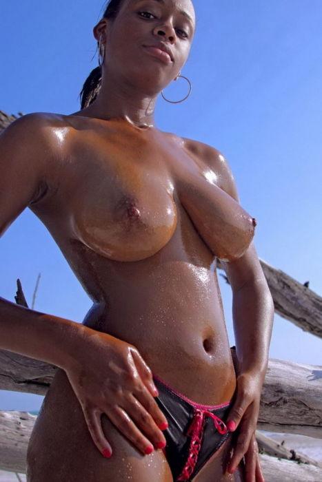 Ebony oiled tits